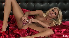 Blonde babe with huge tits enjoys a red dildo inside her pink juicy snatch