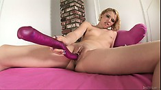 She uses a huge purple dildo to stick into her wet, hungry puss