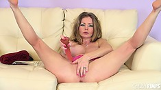Busty brunette Amber Michaels puts on a show of fucking with a toy