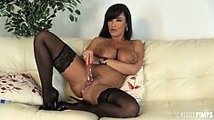 Gorgeous Lisa Ann fucks herself wearing black nylon stockings