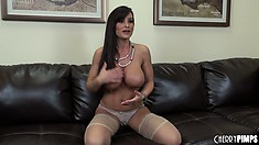 Wonderful posing model Lisa Ann makes her amazing bristols dangle