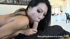 Asian beauty Asa Akira gobbles up his groin and gets drilled on the couch