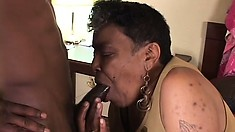 Old chocolate bitch getting a young black cock stuffed into her pussy