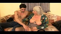 Old hoochie mama gives her young plaything a wonderful blowjob