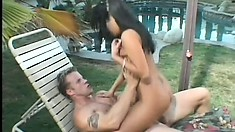 Busty young brunette has a horny guy deeply pounding her sweet pussy by the pool