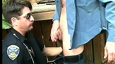 Two horny police officers take turns pleasing each other's big dicks