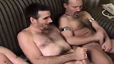 These hung men get playful with a sex swing in their hotel room