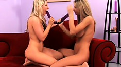 Sammie and Ashley use a huge dildo to please each other's wet pussies