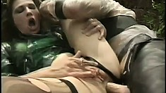 Caged slave gets used hard as he face fucks, fists her ass and gives her a mouthful