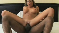 Busty white chick sits on his dark dick and gets filled to the brim
