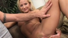 Fresh blonde MILF smiles for the camera while working on a dick