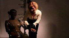 Lesbian mistress entertains herself with her latex clad slaves