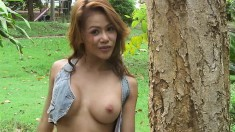 Tight Asian slut takes off her cute outfit and poses naked outside
