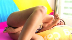 Nuri Mitta sits against the wall and fingers her twat before toying it