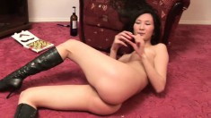 Charming Asian girl in black boots Suong reveals her tight honey hole