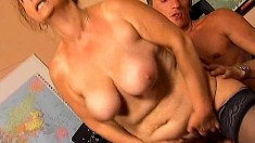 Stacked mature lady in black stockings has wild sex with a young stud