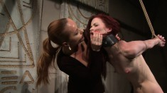 Naughty redheaded broad gets a big fat dildo shoved in her mouth