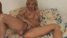 Stacked blonde mature delivers a sensual blowjob and fists her pussy