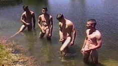 Four attractive young boys taking their dicks to pleasure at the lake