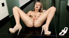 Slender blonde in high heels spreads her legs and rubs her sweet peach