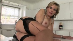 Voluptuous blonde housewife in lingerie exposes herself for the camera