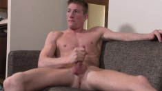Enticing gay stud Jacob fingers his tight ass and strokes his big dick