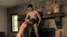 Two college studs indulge in passionate anal fucking by the fireplace