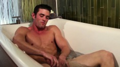 Attractive guy fingers his fiery ass and vigorously strokes his dick