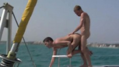 Enthusiastic gay friends get together on a boat and engage in anal sex