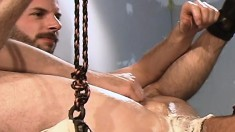 Bearded and bald stud spreads his legs wide to take his tattooed buddy's fist in his ass