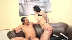 Inked brunette in fishnet stockings satisfies her lust for black meat