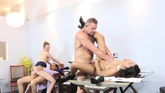 Blonde And Brunette Cuties Getting Banged By Hung Studs In The Office