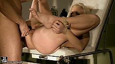 Blondie is too tired to fight the evil doctor as he takes advantage of her holes