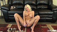 Blonde bombshel Riley Evans makes herself moan with a big dildo