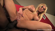 Busty blonde with a heavenly ass is in need of a huge black rod in her tight pussy