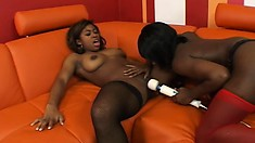 Dirty ebony lesbian loves using a strap-on to make her girl moan
