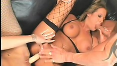 Two striking babes seduce a horny guy and have him pounding their holes on the couch