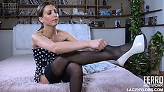 Madeleine sensually exposes her sexy tits, perky ass and hot long legs