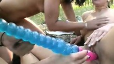 Bootylicious young babe and her naked friends have fun outdoors