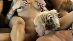 A big group of lesbians get rough and nasty on each other's pussies
