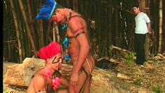 Horny tribe members show their captive what gay sex is all about