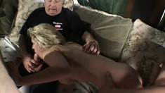 Blond babe works on all three cocks while her husband watches