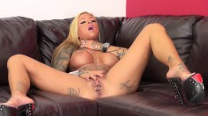 Tattooed blonde with big hooters Britney Shannon shows off her holes