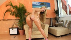 Cock-hungry Carol spreads her fine legs to give herself a sexy massage