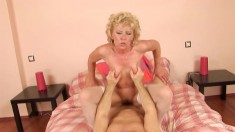 Stacked mature lady in white stockings goes crazy for a throbbing pole