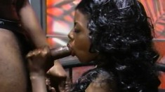 Buxom chocolate beauty in red stockings has wild sex with a black guy