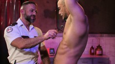 Suspended studs get their cocks tortured by a bearded master