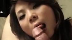 Blowjob by beautiful Asian mouth